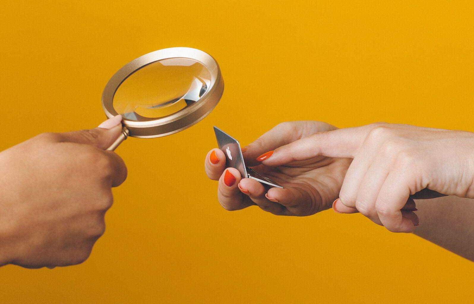 magnifying glass on tiny laptop