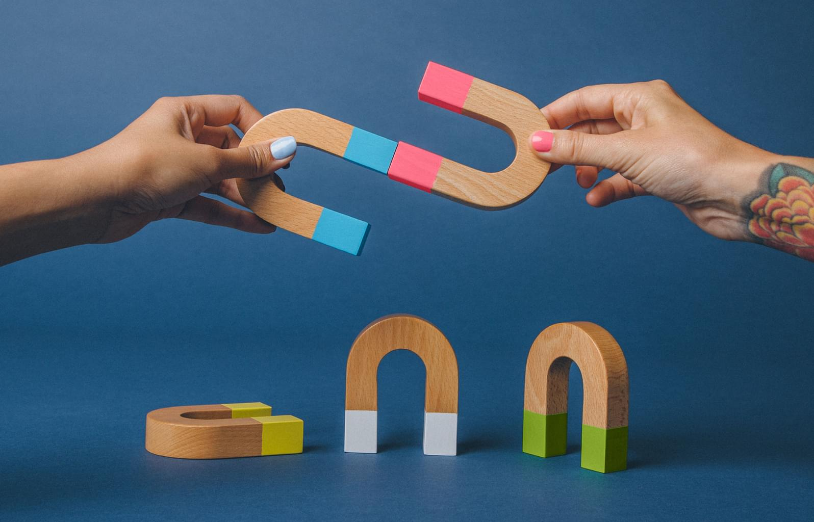 Hands and U-shaped magnets coming together